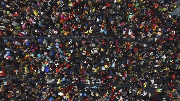 Rush to go home: passengers stranded in Guangzhou on February 2. China's travel rush ahead of Lunar New Year was ...