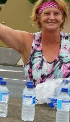 Wendy McCreadie stocked her car with water bottles and handed them out to motorists stuck on the freeway in stifling ...