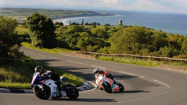 Practice laps for a TT Superbike race on the Isle of Man. The tiny self-governing island is considering giving up its ...