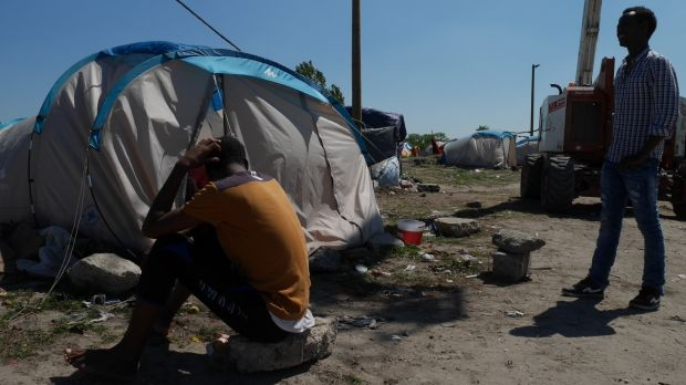 Daniel, an Eritrean, outside his tent in The Jungle in Calais, France, while waiting to go to London last year. One of ...