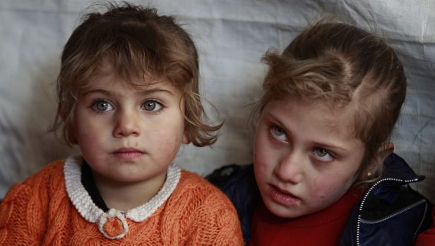 Eman al-Aqraa, 8, right, and her sister Fatima, 4, at a Syrian refugee camp in Lebanon.