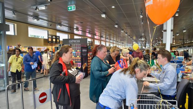 Local Samantha Shaw, left, checks out at the grand opening of the first Aldi store in South Australia.