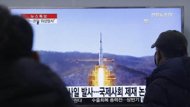South Koreans watch a TV news program on North Korea's rocket launch plans at Seoul Railway Station on Wednesday.