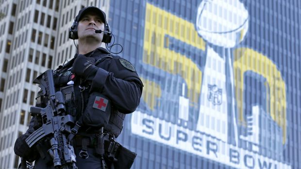 San Francisco Police tactical unit officer Jeff McHale watches the crowd at Super Bowl City in San Francisco. Security ...