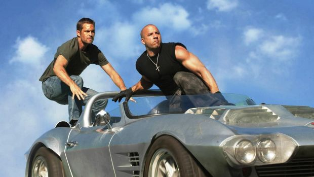 Paul Walker and Vin Diesel in scene from one of the <i>Fast & Furious </i>films.