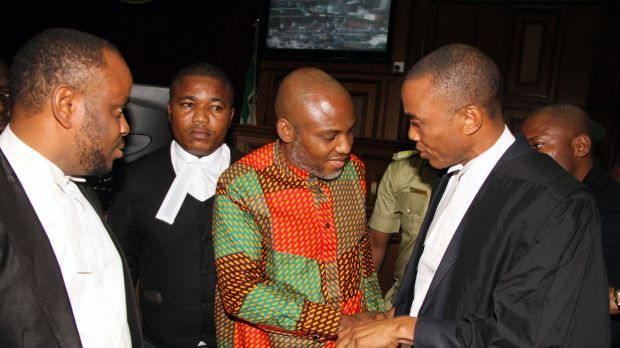 Biafran separatist leader Nnamdi Kanu, centre, speaks to his lawyers at the Federal High Court in Abuja, Nigeria, on Friday.