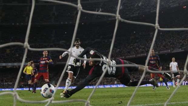FC Barcelona's Lionel Messi scores against Valencia's goalkeeper Mathew Ryan.