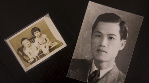 A photo of Guo Ching, right, a victim of the political repression known as the White Terror, and a photo of his ...