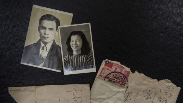 Liu Yao-ting, left, a victim of the White Terror, and his wife, Yueh-Hsia, and the letters written between them at the ...