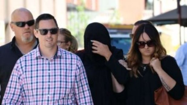 Janet Louise Kirby, who killed her daughter after losing control of her car in Merriwa, arrived at court with her head ...