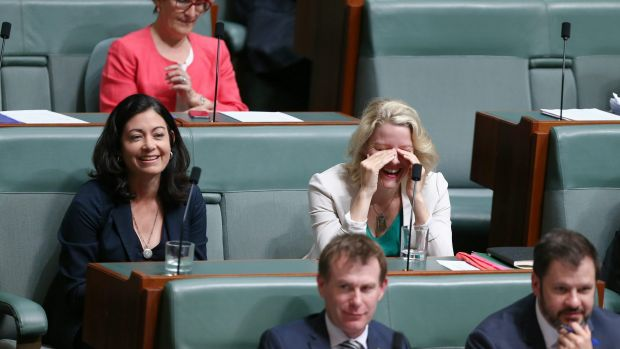 Labor MPs Terri Butler and Clare O'Neil listen to Prime Minister Malcolm Turnbull in question time on Thursday.