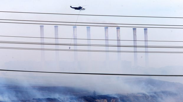 Water bombing helicopters attack the fire in the coal pit at Hazelwood power station in 2014.