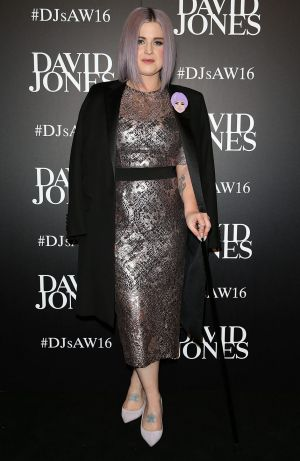 Osbourne was dressed to kill in a chic Rebecca Vallance lilac lace number with a cane to support her broken foot.