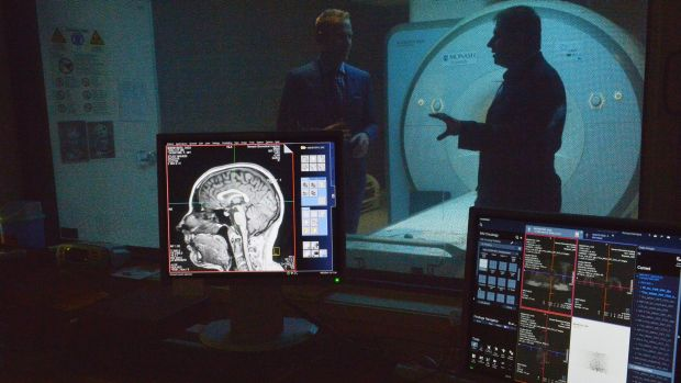Research scientists Pascal Molenberghs, left, and Juan Dominguez, right, analysed MRI scan results  showing the effects ...