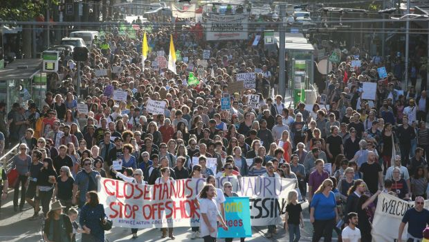 Thousands flooded through Melbourne in Thursday's 'Let Them Stay' rally.