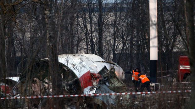Disintegrated in the air ... Authorities inspect the debris on the site of the plane crash that killed Polish President ...