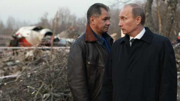 The then Russian prime minister Vladimir Putin, right, and Emergency Situations Minister Sergei Shoigu, left, visit the ...