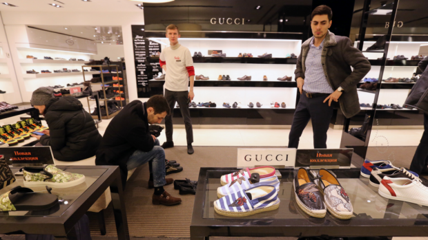 Customers try on luxury brand shoes in the TsUM department store in Moscow.