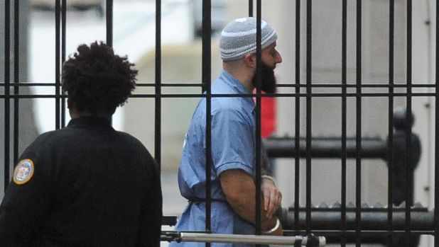 Adnan Syed walks into the court in Baltimore before a hearing on Wednesday.