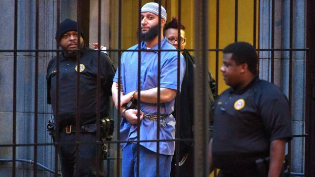 Retrial ordered ... Adnan Syed is escorted from a Baltimore court.