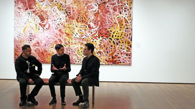 Vernon Ah Kee, Stephen Gilchrist, and Narayan Khandekar at the Harvard Art Museum exhibition in front of Emily Kame ...