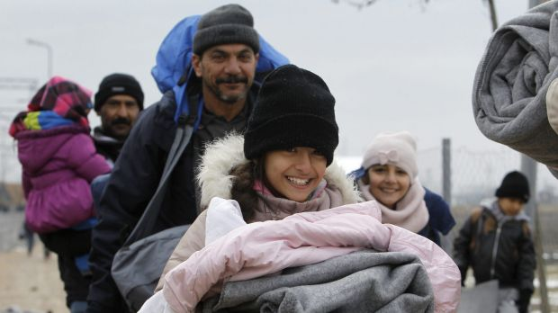 Iraqi refugees in Macedonia walking towards the Serbian border last week.