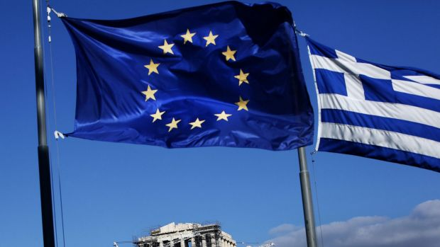 Athens under two flags, Greece's and the EU's.