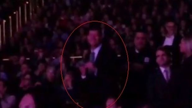 Packer shuffling about as he watches Carey on stage at The Colosseum at Caesars Palace on Tuesday night.
