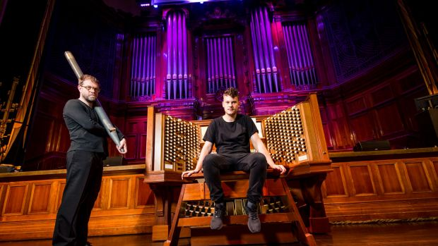 Composers Austin Buckett and Simon James Phillips, who is holding one of the organ pipes removed for Exit Ceremonies.