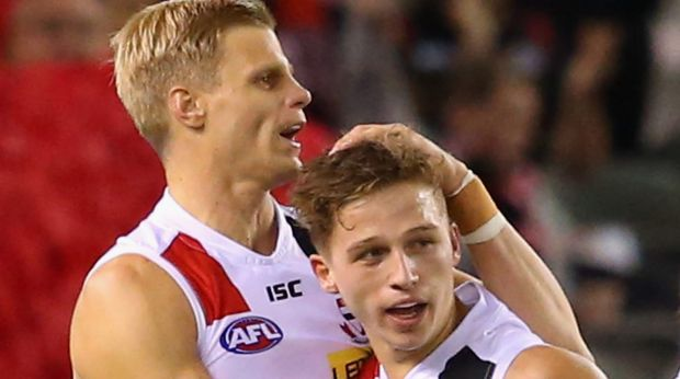 Jack Billings of the Saints is congratulated by Nick Riewoldt after kicking a goal.