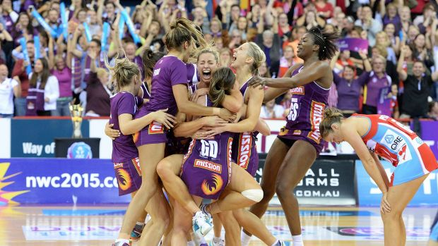 Jubilation: Laura Geitz and the Firebirds celebrate last year's grand final win.