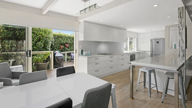 An open-plan living, dining and kitchen area is the property's central hub.
