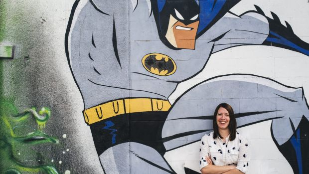 The ACT's new graffiti co-ordinator Louise Emberson with legal street art in Tocumwal Lane off Garema Place.