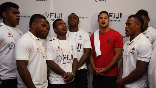 Inspirational: Jarryd Hayne (3rd from right, red T-shirt) with members of the Fiji Sevens team at a pop-up Fijian bar in ...