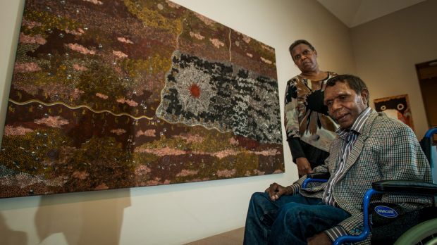 Artist Clifford Possum Tjapaltjarra's children Gabriella, from Melbourne, and Lionel Possum, from Alice Springs, see ...