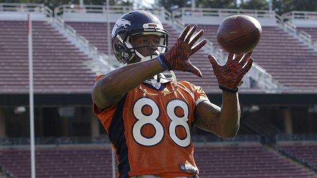 Shaky hands: Demaryius Thomas practices on Thursday - he has dealt with dropping the ball too many times all year.
