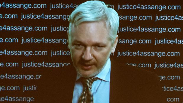 Julian Assange speaks at a press conference via a video link from the Ecuadorian Embassy in London on February 5, 2016.