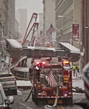 A collapsed crane lies upside down along Worth Street.
