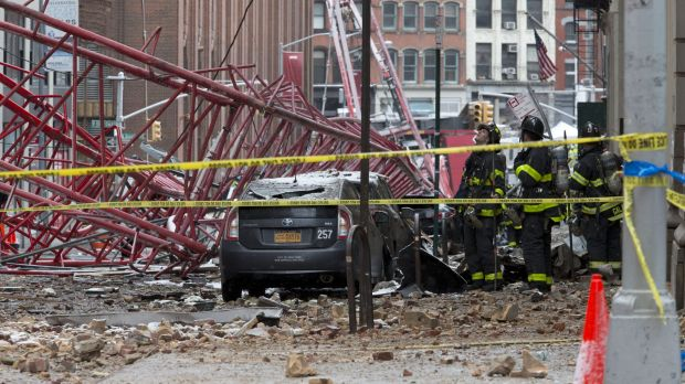 Firefighters work at the scene of a crane collapse in lower Manhattan.