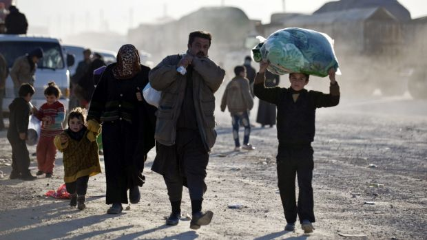 Syrians walk towards the Turkish border in the hope of finding sanctuary.