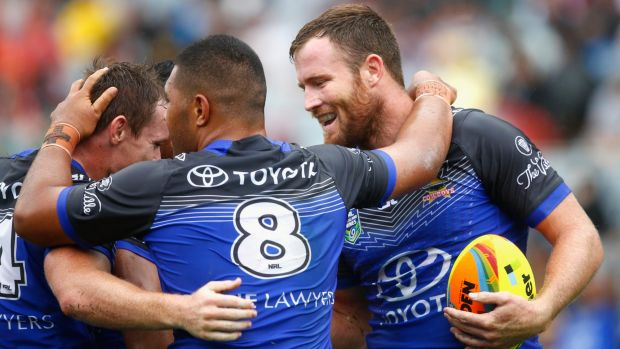 Fast start: Gavin Cooper of the Cowboys (R) celebrates his try against Newcastle.