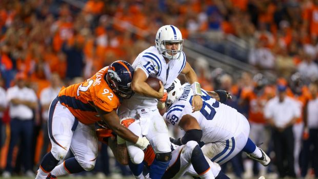 In action: Sylvester Williams grabs Indianapolis quarterback Andrew Luck during a regular season game.