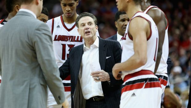Banned: Rick Pitino gives instructions to his Louisville Cardinals team.