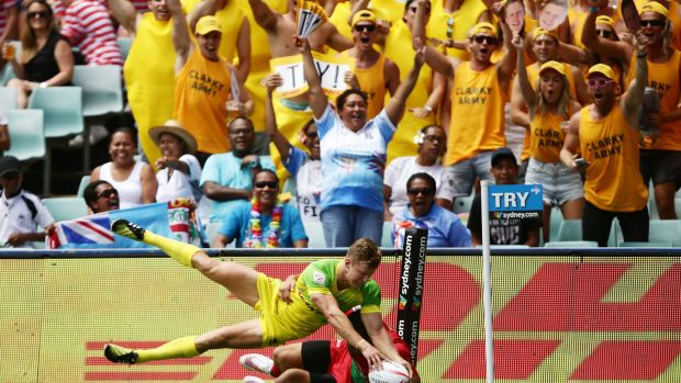 Three-try hero: Cameron Clark touches down for Australia during the Sydney Sevens.