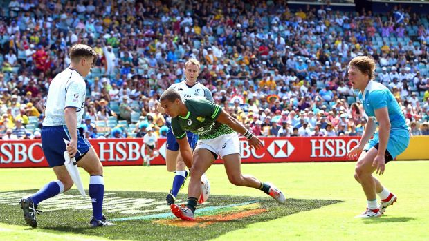 Sea of colour: South Africa's Cheslin Kolbe touches down in front of a huge crowd at Allianz Stadium earlier this month.