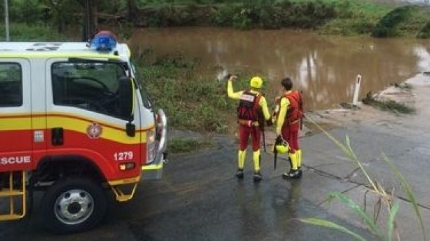 Rescuers searching for a man who could have driven a stolen car in to floodwaters at Scrubby Creek.