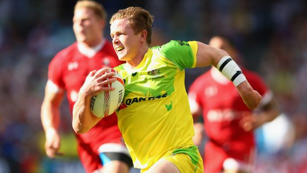 Golden run: Australia's Henry Hutchison takes on Canada.
