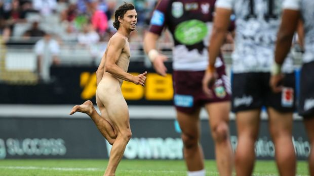 A streaker runs onto the field during the Auckland Nines match between the Warriors and the Sea Eagles.
