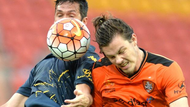 Luis Garcia of the Mariners and James Donachie of the Roar challenge for the ball.