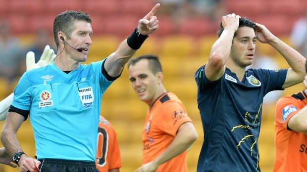Harry Ascroft of the Mariners is given a red card by referee Matthew Conger.